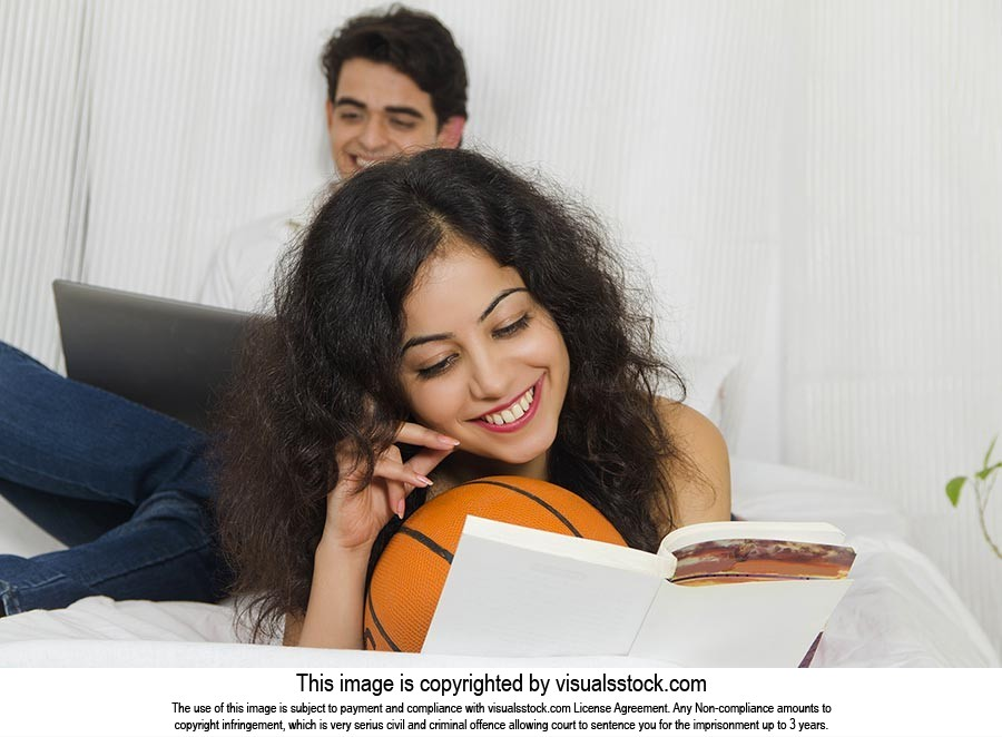 2 Couple Young Woman Lying On Bed Reading Book In