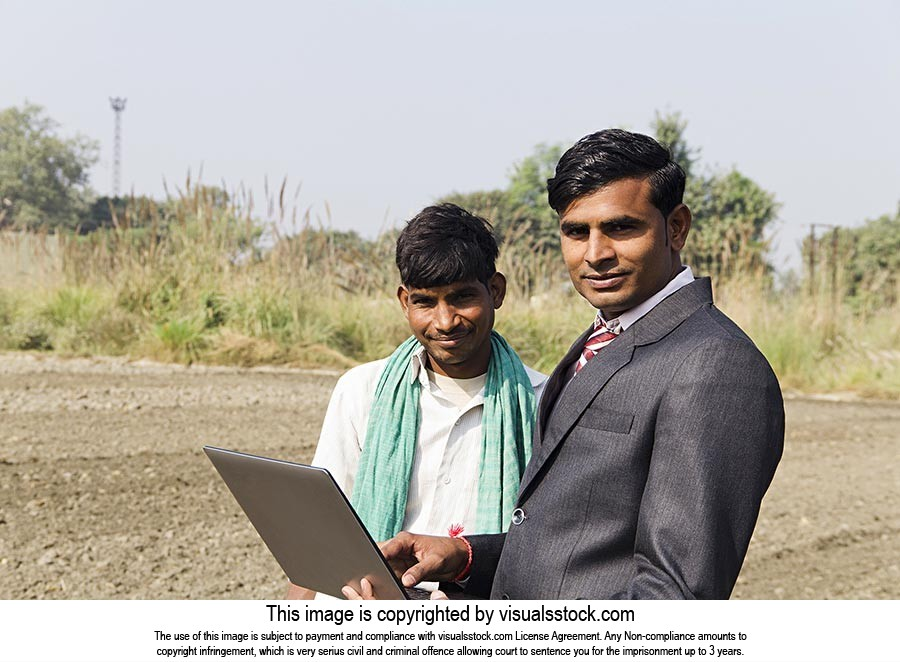 Businessman Farmer Using Laptop Farm