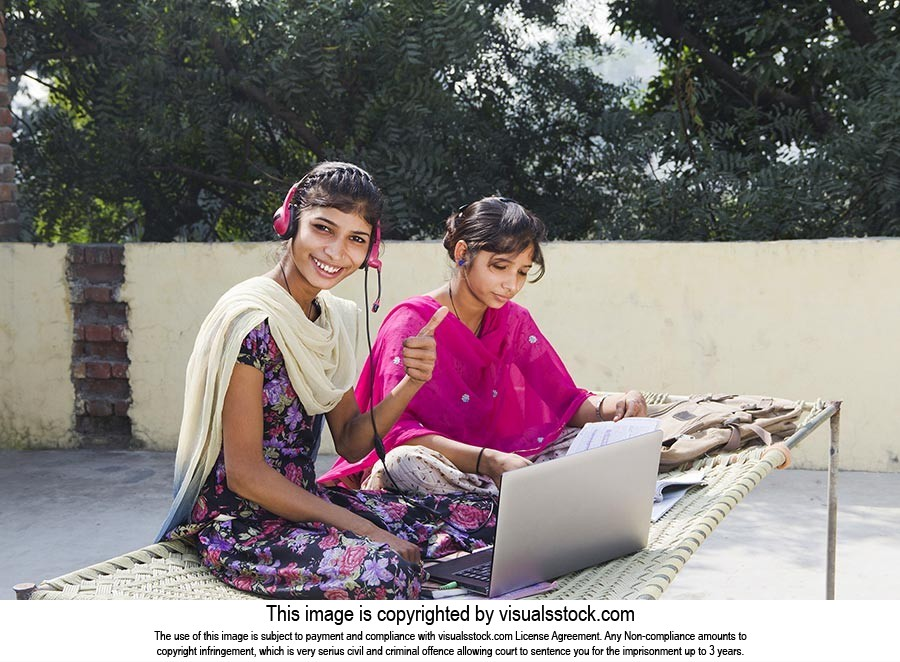 2 Indian Rural Girls Sister Sitting On Cot headset