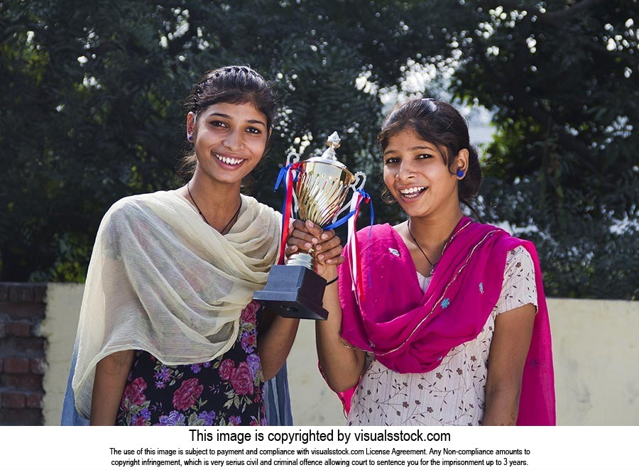 2 Indian Rural Girls Student Standing On Roof Hold