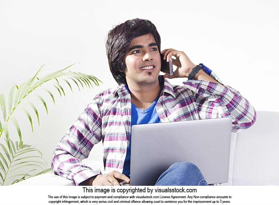 Teenager Boy at home Laptop Talking Phone