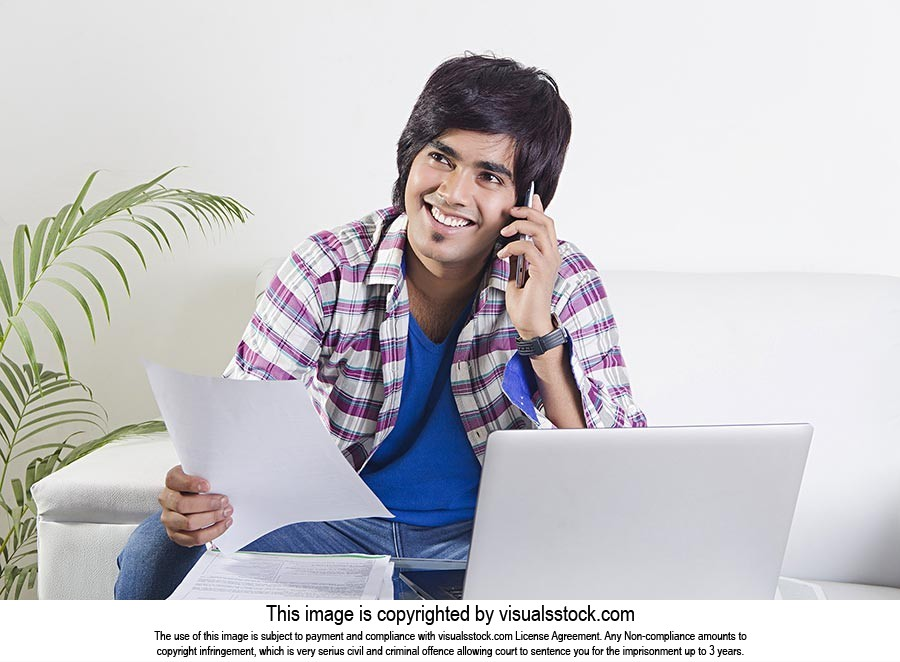 Young Man Sitting Home Bill Paper Tlking Phone