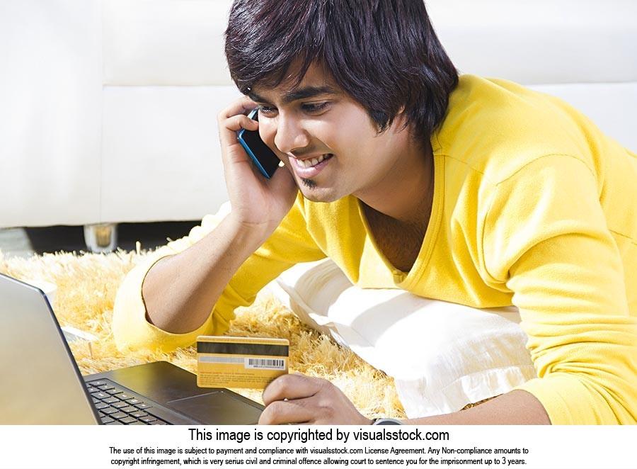 Man Home Laptop Credit Card Booking Talking Phone