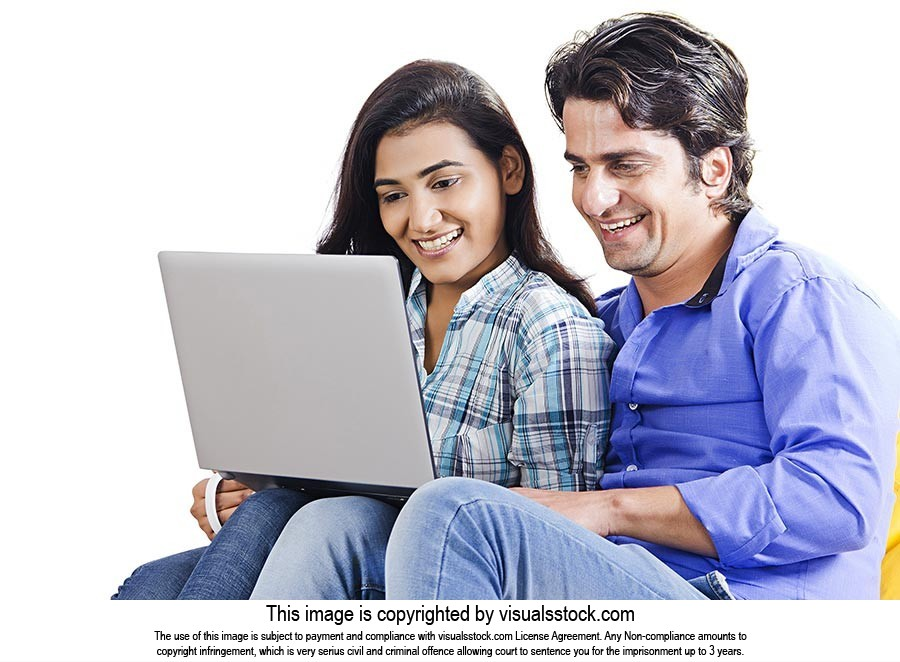 Indian Couple Sitting Together Using Laptop Chatti