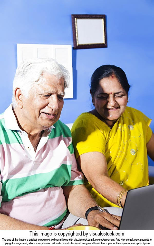 Indian Old Couple Sitting Home Laptop Working