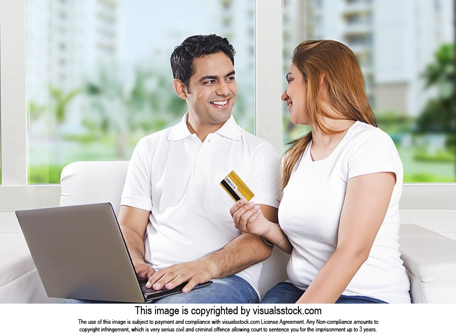 Indian Couple Credit Card Laptop