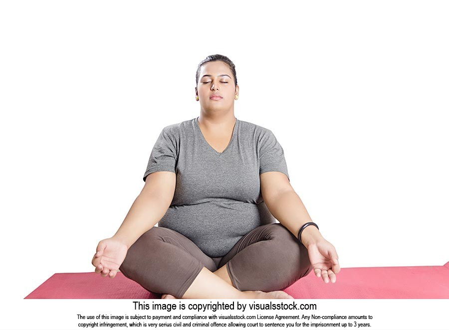 Indian Fat Woman Sitting On Mat Doing Yoga Ardha Padmasana Fitness Exercise