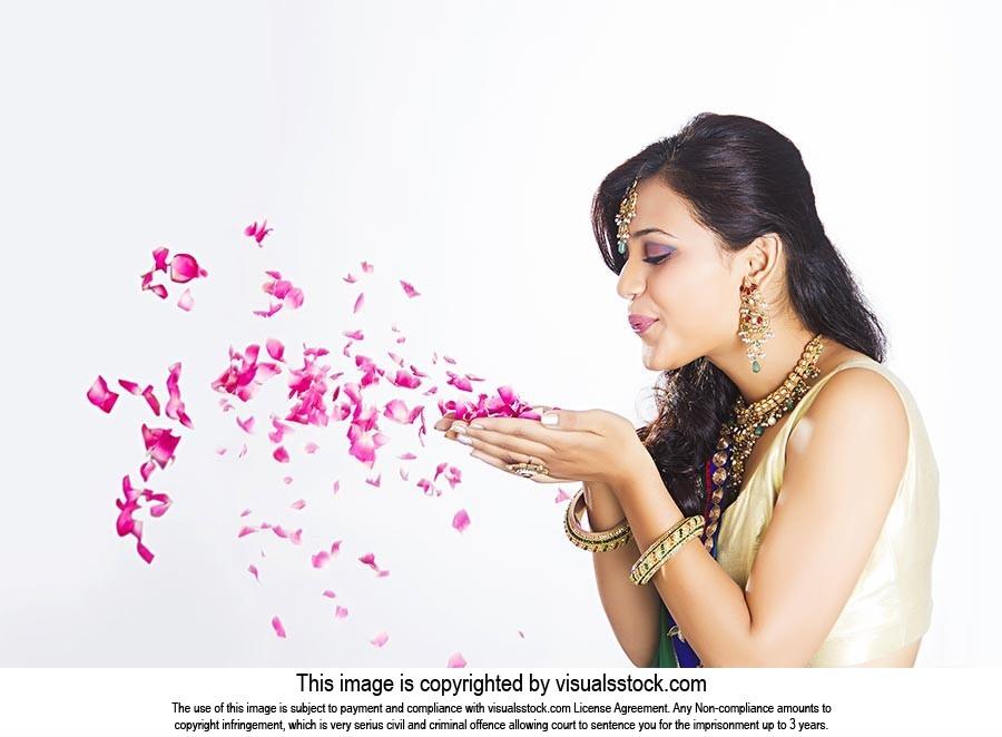 Indian Beautiful Woman Blowing Rose