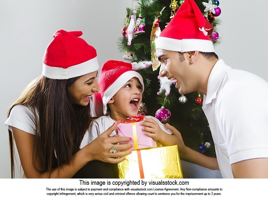 Surprise d Boy Receiving Christmas Gift Parents Ex