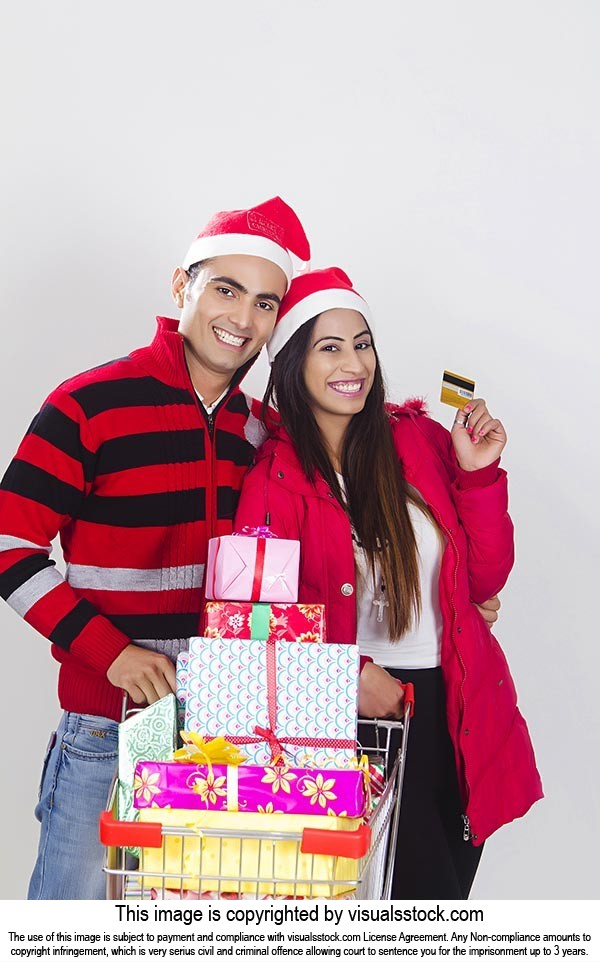 Couple christmas Credit card shopping gift cart
