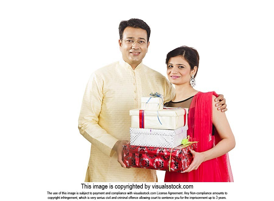 Portrait Couple Holding Gift Boxes