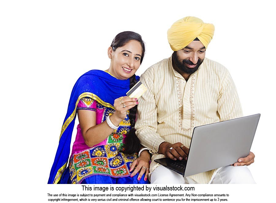 Sikh Couple Online Shopping Credit card Laptop
