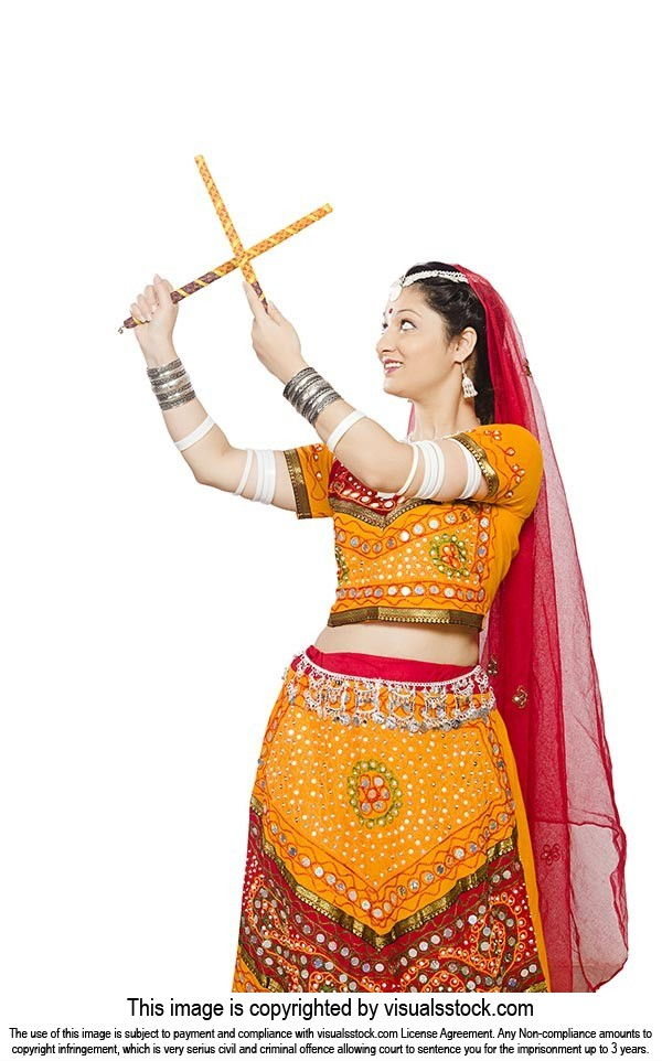 Woman Chaniya Choli Performing Dandiya Raas