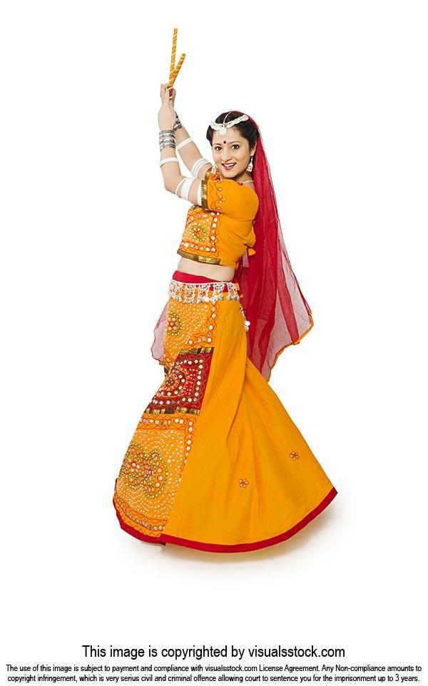 Woman Lehenga Choli Performing Dandiya Dance