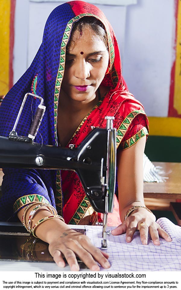 Rural Woman Using Sewing Machine