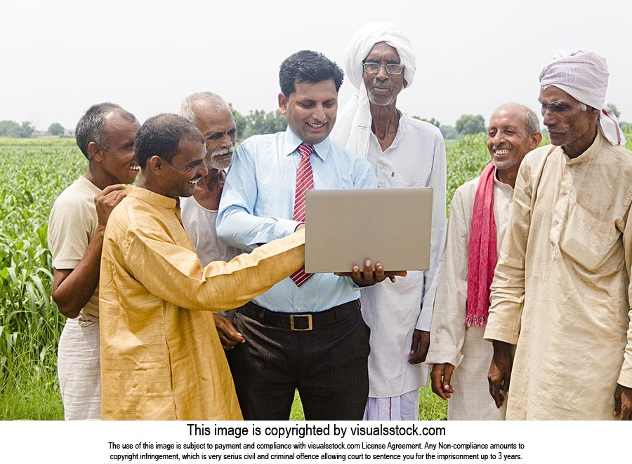 Businessman Farmer Laptop Explaining