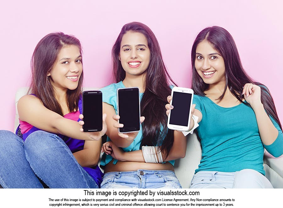 Teenage Girls Showing Phone