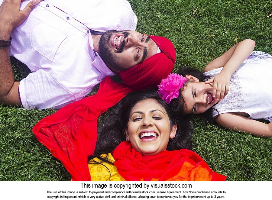 Indian Parents Daughter Laying Park