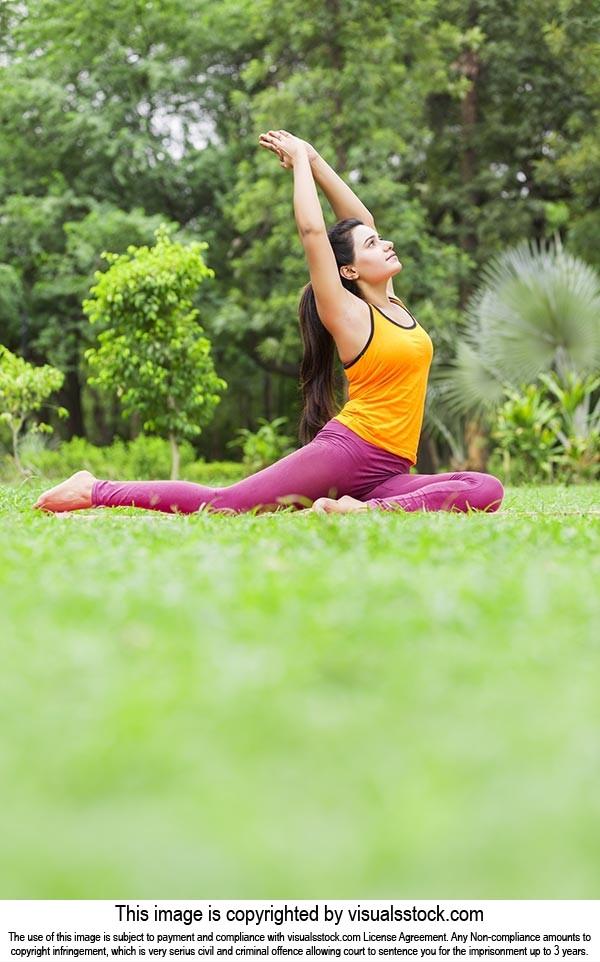 Indian Woman Practices Yoga Asana Ashva Sanchalasana Fitness Exercise Workout At Park