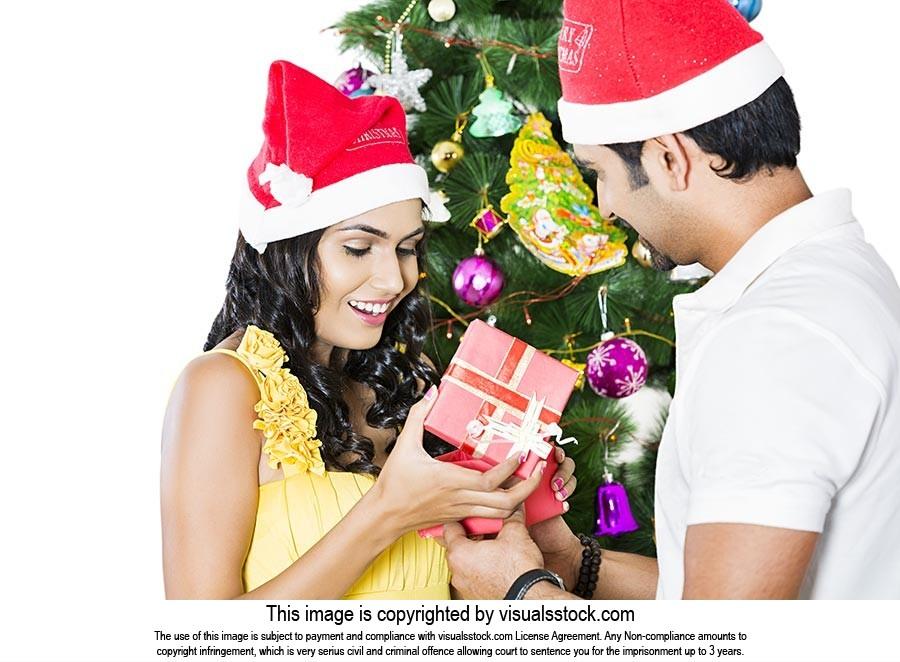 Couple Opening Christmas Presents