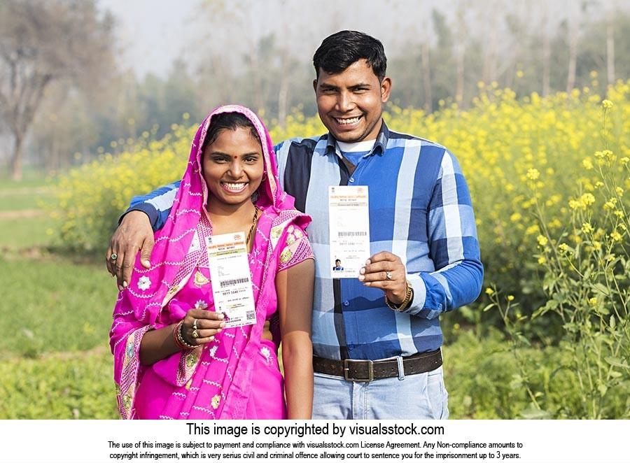 Rural Couple Field Showing Aadhaar Card Smiling