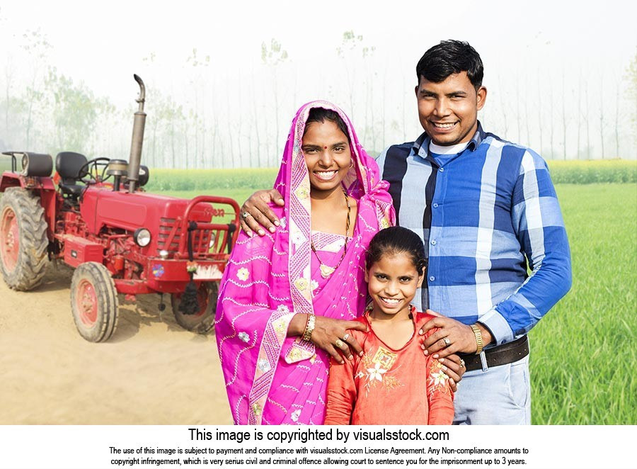 Rural Farmer Parents Daughter Field Standing Smili