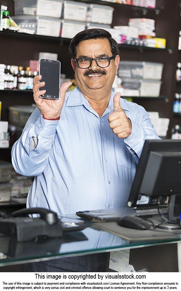 Chemists Shop Shopkeeper Man Showing Cellphone Thu