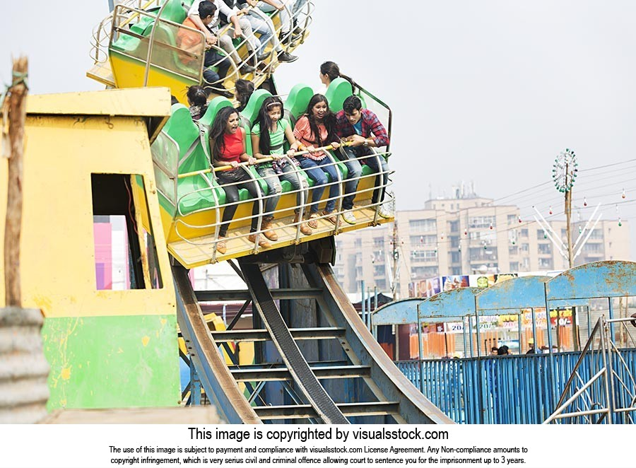 Young Friends Enjoying Cheering Roller coaster Rid