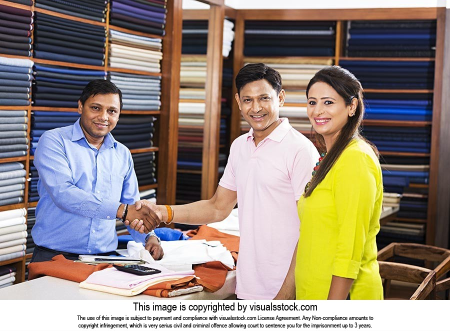 Garments Showroom Salesman Customer Shaking Hands
