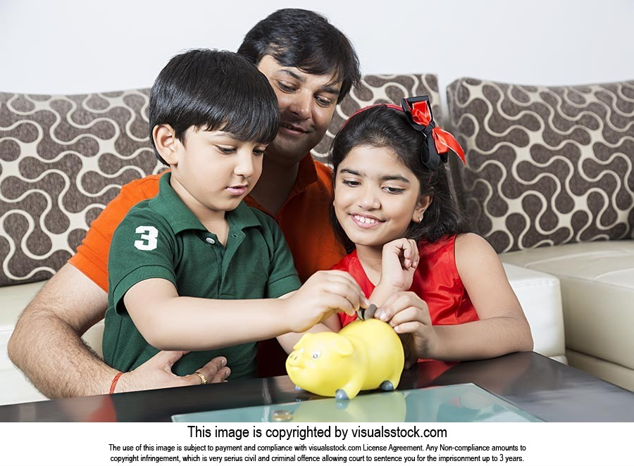 Father And Little Son And Daughter Saving Money Pu