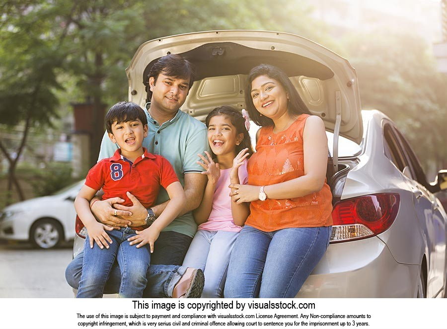 happy loving family sitting together in the trunk