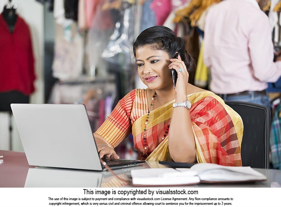 1 indian Woman Boutique owner Laptop Working and t