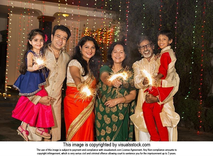 Joint Family Celebrating Diwali Festival Fire Crac