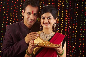 Indian Couple Diwali Gold Coin Lottery