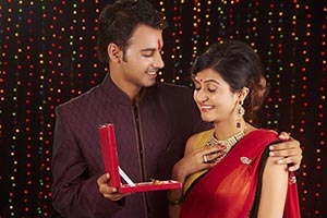 Indian Husband Giving Gift Necklace Wife