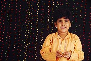 Boy Holding Diya Smiling Diwali Festival