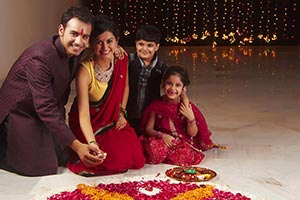 Family Preparing Rangoli Diwali Festival