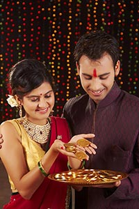 Couple Golden Coins Diwali Festival Celebrating