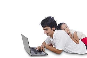 Dad laptop working and Daughter girl sleeping on b