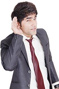 Young attractive businesswoman listening gossip
