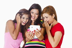 Surprised Womens Reading Text Message Digital Tabl