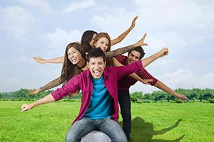 Happy Friends Standing Park Arms Outstretched Toge