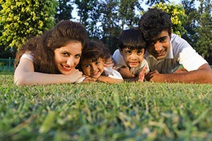 Happy Family Lying Grass Park Enjoying Weekend Act