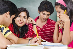 student friends studying together in a classroom P