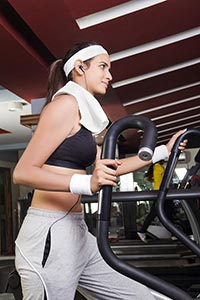 Young Woman weight loss exercise equipment Machine