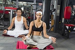 Couple meditating gym Padmasana yoga Fitness exerc
