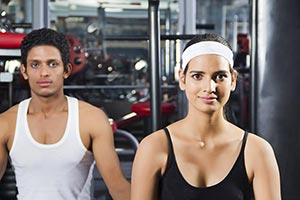 healthy Man and Woman doing exercise for relaxatio