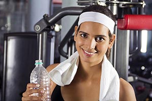 Indian Woman Resting Drinking Water Exercising Gym