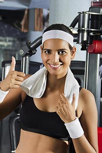 Muscular Woman Showing Thumbs up Gym Fitness Exerc