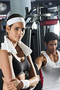 indian fitness woman Arms Crossed standing gym Cen